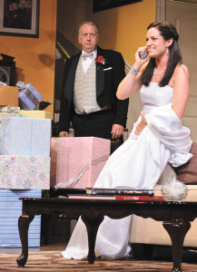 Stanley Sees Kay's Look: Stanley Banks (Jeff Stockberger) realizes how happy his daughter Kay (Lisa Ermel) is as she talks to her fiancé in Beef & Boards Dinner Theatre's production of Father of the Bride, now on stage through Sept. 29.