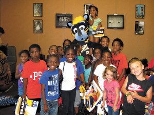 submitted photoPacers mascot Boomer celebrates reading achievement with children from Secret Place Day care during the Indiana Pacers Reading Time Out at the Irvington Branch of The Indianapolis Public Library, as part of the Library's summer reading lineup of events.