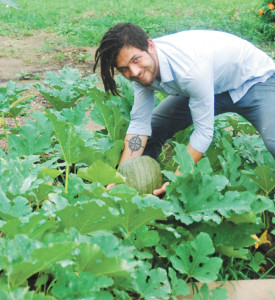 CJ Woods III/Weekly ViewKaine and a watermelon.
