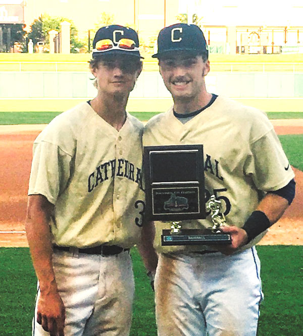 submitted photo (left) Seth Link #3 center fielder and Jarod Poland #25 shortstop holding the Championship trophy (both are juniors at Cathedral).